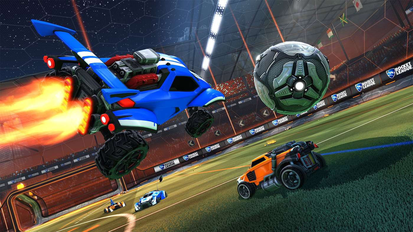 A blue car leaps over an orange car to steal the ball