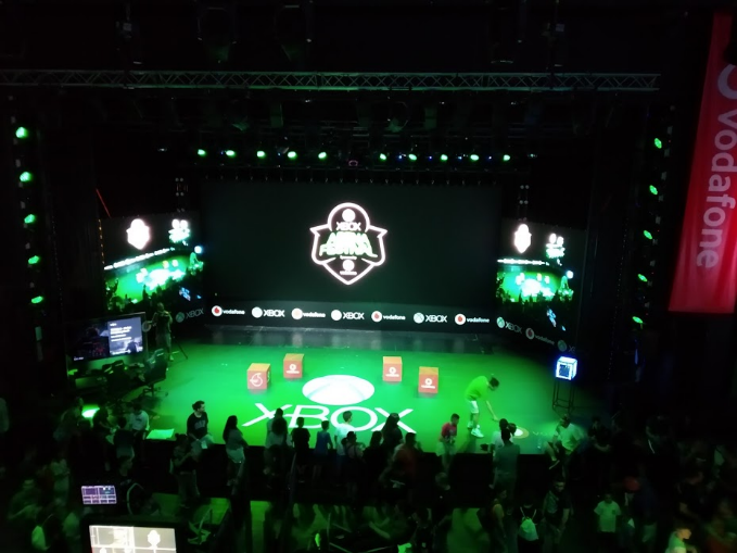 A view of the stage displaying the Xbox Arena Festival logo on the main screen