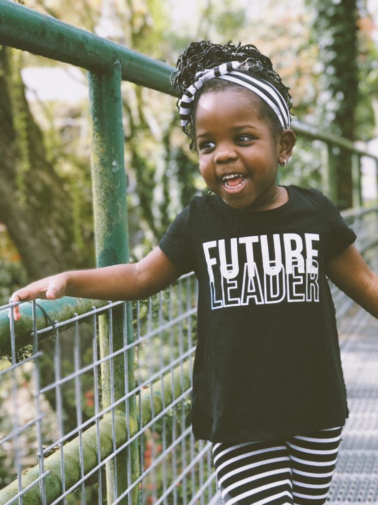 young-girl-wearing-a-shirt-that-says-future-leader