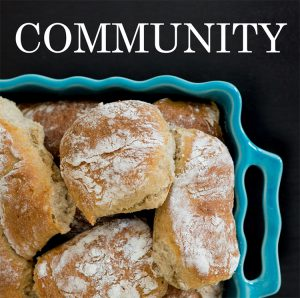 text-reading-community-over-picture-of-bread-rolls