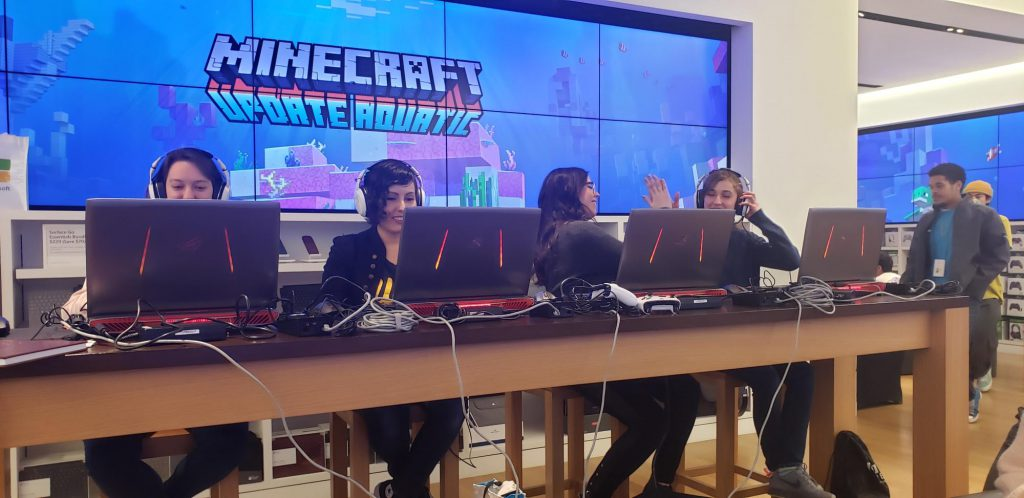 Four women on computers playing Minecraft