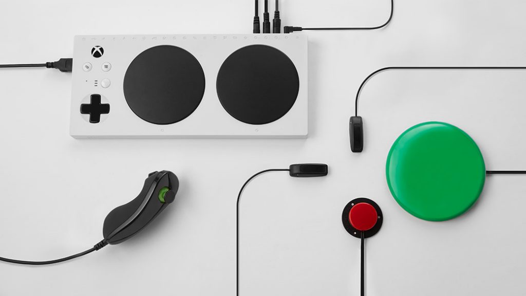 Image of the top-down view of an Xbox Adaptive Controller and its additional accessories