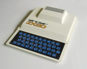photo of a Sinclair ZX80 machine that is white and has a blue keyboard