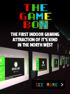 "screens with the Xbox home menu on them and the words ""The Game Box, the first indoor gaming attraction of it's kind in the north west"""